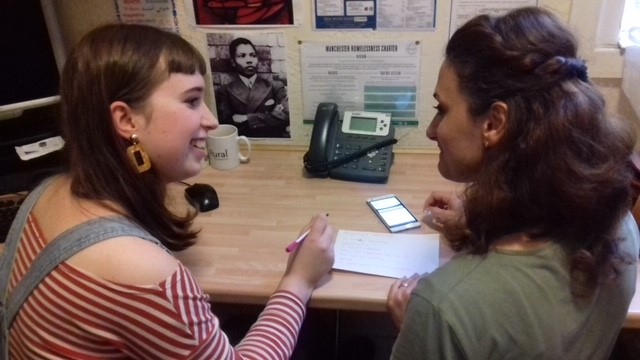 Tutor giving one to one support to a learner