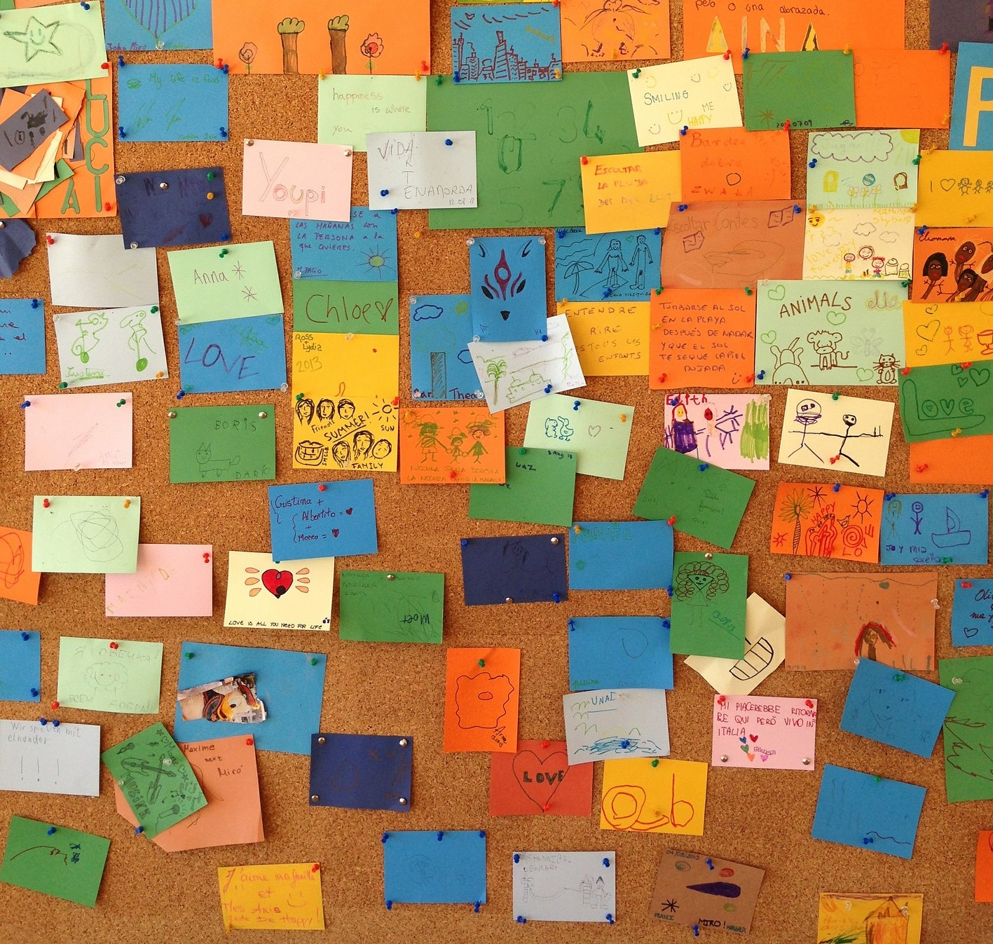 Pinboard with lots of coloured post-it notes attached